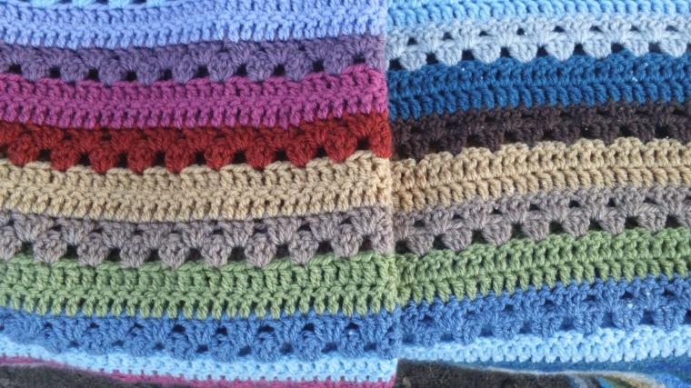 the blankets share 7 common colours and row placement