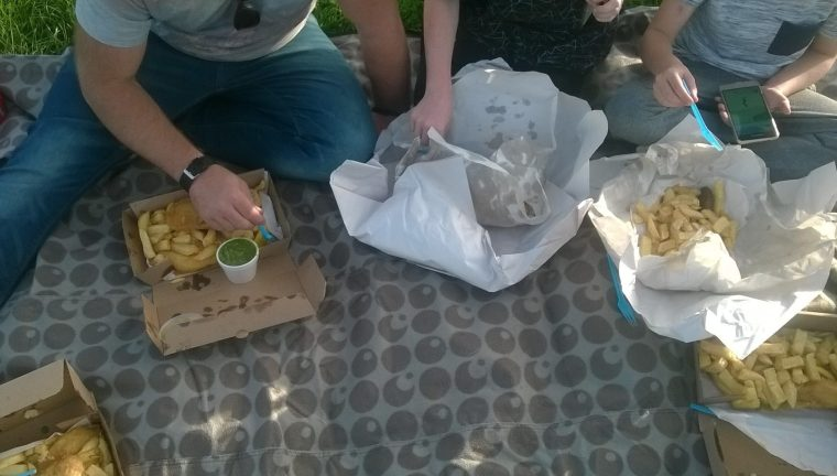 Enjoying a fish and chip picnic