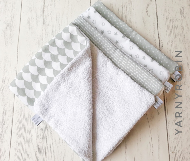 grey and white burp cloths
